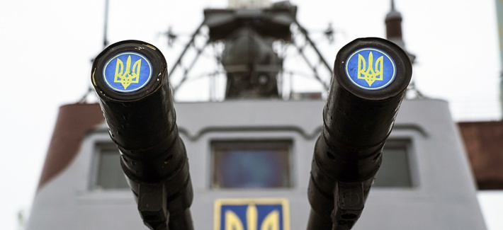 Lids emblazoned with a Ukrainian emblem cover the barrels on a gun mount aboard a Ukrainian coast guard ship in the Sea of Azov port of Mariupol, eastern Ukraine, Monday, Dec. 3, 2018.