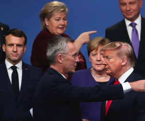 NATO Secretary General Jens Stoltenberg, center front left, speaks with U.S. President Donald Trump, center front right, after a group photo at a NATO leaders meeting in England, Wednesday, Dec. 4, 2019.