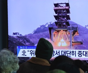 "People watch a TV screen at the Seoul Railway Station in Seoul, South Korea, on Dec. 9, 2019. North Korea said Sunday it carried out a ""very important test"" at its long-range rocket launch site. The sign reads: ""Very important test."""