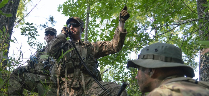 Soldiers with the 1st Battalion, 167th Infantry Regiment, 53rd Infantry Brigade Combat team establish radio communications with their headquarters element during a reconnaissance mission as part of XCTC 19-05, Aug. 8, 2019 at Camp Shelby, MS.