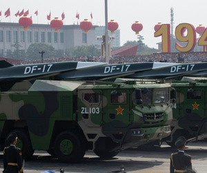 Chinese military vehicles carrying DF-17 missiles roll during a parade to commemorate the 70th anniversary of the founding of Communist China in Beijing, Tuesday, Oct. 1, 2019.