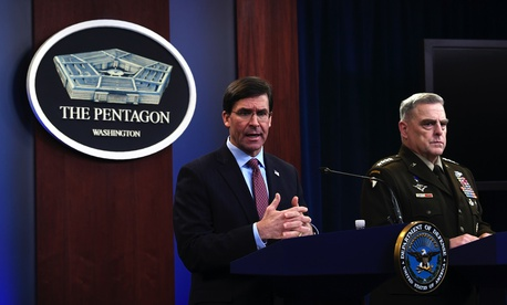 Joint Chiefs Chairman Gen. Mark Milley and Defense Secretary Mark Esper speak during a news conference at the Pentagon in Washington, Friday, Dec. 20, 2019.