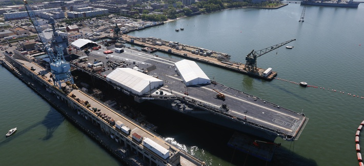 In this April 27, 2016 photo, USS Gerald R. Ford is stationed at Newport News Shipbuilding in Newport News, Va.