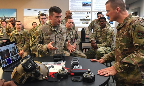 Capt. Alex Jessop, 821st Contingency Response Squadron, , shows a 3D printed adapter to a Phantom brand tactical airfield lights to Col. Douglas Jackson, 621st Contingency Response Wing commander, during Jackson's immersion tour June 24, 2019.
