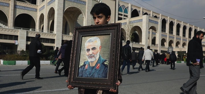 A boy carries a portrait of Iranian Revolutionary Guard Gen. Qassem Soleimani, who was killed in the U.S. airstrike in Iraq, prior to the Friday prayers in Tehran, Iran, Friday Jan. 3, 2020.