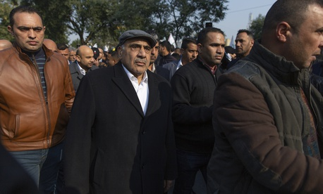 Iraqi acting Prime Minister Adil Abdul-Mahdi takes part in the funeral of Iran's top general Qassem Soleimani and Abu Mahdi al-Muhandis, deputy commander of Iran-backed militias in Iraq known as the Popular Mobilization Forces, in Baghdad, Iraq, Saturday,