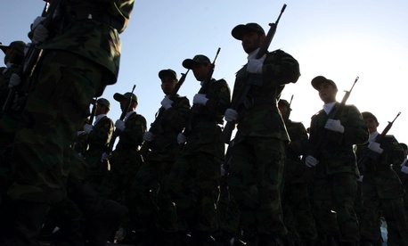 In this 2007 photo, members of the Islamic Revolution Guards Corps forces parade in Tehran to mark the 27th anniversary of the Iraqi invasion of Iran.