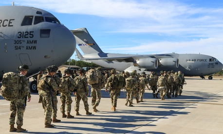 Army paratroopers assigned to the 2nd Battalion, 504th Parachute Infantry Regiment deploy from Pope Army Airfield, N.C., Jan. 1, 2020.