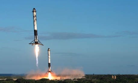 Two reusable rocket boosters land after the successful launch of SpaceX's Falcon Heavy Arabsat 6A on April 12, 2019, at Kennedy Space Center, Fla.