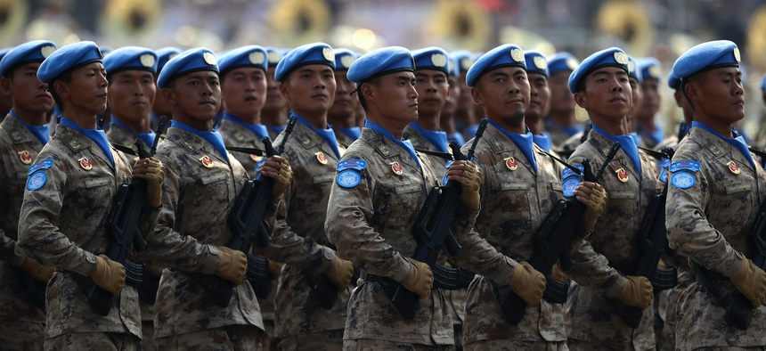 Chinese United Nations (UN) peacekeeping forces march in formation during a parade to commemorate the 70th anniversary of the founding of Communist China in Beijing, Tuesday, Oct. 1, 2019.