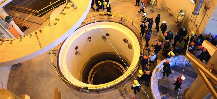 Technicians work at the Arak heavy water reactor's secondary circuit, as officials and media visit the site, near Arak, 150 miles (250 kilometers) southwest of the capital Tehran, Iran, Monday, Dec. 23, 2019.
