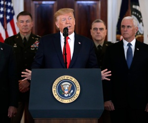 President Donald Trump addresses the nation from the White House on the ballistic missile strike that Iran launched against Iraqi air bases housing U.S. troops, Wednesday, Jan. 8, 2020, in Washington, as Vice President Mike Pence and others look on.