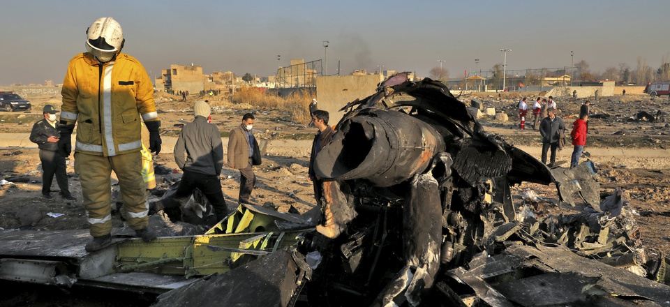 Rescue workers search the scene where a Ukrainian plane crashed in Shahedshahr, southwest of the capital Tehran, Iran, Wednesday, Jan. 8, 2020.