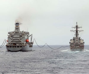 The fleet replenishment oiler USNS Henry J. Kaiser (T-AO-187) refuels the aircraft carrier USS Theodore Roosevelt (CVN 71) and the guided-missile destroyer USS Higgins (DDG 76) during a replenishment-at-sea.