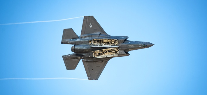 "Capt. Andrew ""Dojo"" Olson, F-35 Demonstration Team pilot and commander performs a weapons bay doors pass during an F-35 Demo practice at Luke Air Force Base, Ariz., Jan. 16, 2019."