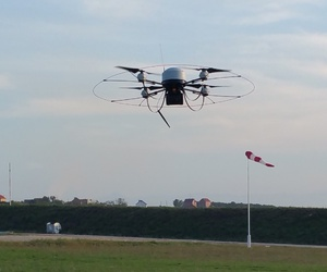 A German military Mikado quadcopter flies through the air during a 2015 unmanned aircraft system demonstration at Camp Marechal de Lattre de Tassigny in Kosovo.