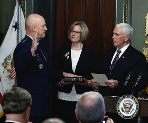 Vice President Mike Pence, right, swears in Air Force General John Raymond as Chief of Space Operations, as his wife, Molly, center, holds a bible in the Ceremonial office at the Executive Office Building, Tuesday, Jan. 14, 2020, in Washington.