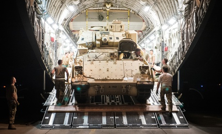 An M2 Bradley Fighting Vehicle is loaded onto a U.S. Air Force C-17 Globemaster III at Ali Al Salem Air Base, Kuwait, Oct. 30, 2019.