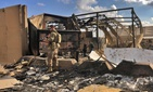 U.S. soldiers inspect rubble at a site of Iranian bombing, in Ain al-Asad air base, Anbar, Iraq, Monday, Jan. 13, 2020.