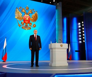 Russian President Vladimir Putin listens the national anthem after his speech to the State Council in Moscow, Russia, Wednesday, Jan. 15, 2020.