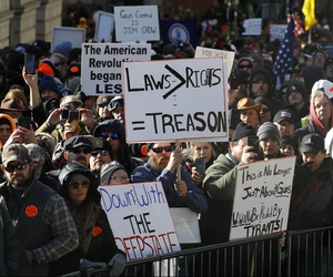 Gun-rights supporters demonstrate in front of the state Capitol in Richmond, Va., Monday, Jan. 20, 2020.