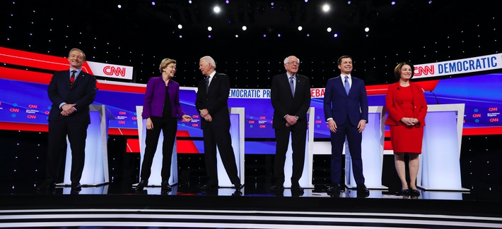 Democratic presidential candidates stand on stage, Tuesday, Jan. 14, 2020, before a Democratic presidential primary debate hosted by CNN and the Des Moines Register in Des Moines, Iowa.