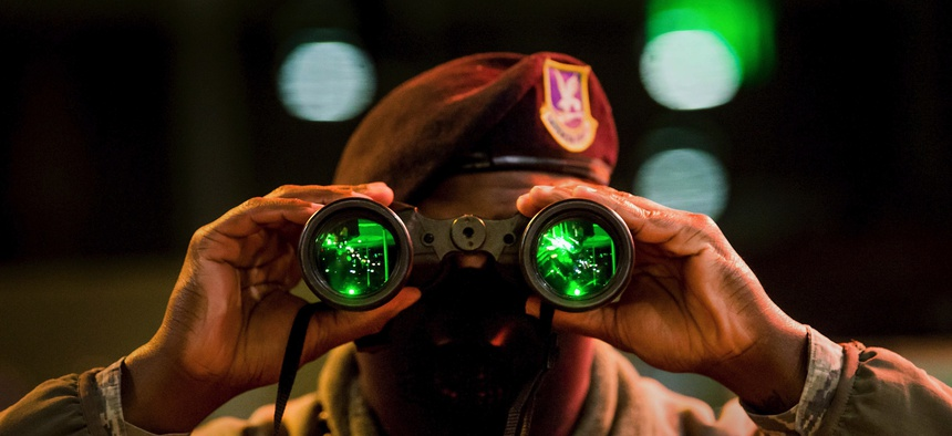 Air Force Airman 1st Class Richard Scott, a security forces installation entry controller, uses night vision binoculars during a night shift at the North Gate at the U.S. Air Force Academy in Colorado Springs, Colo., Jan. 7, 2020.