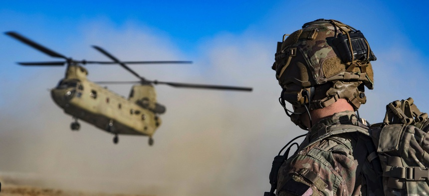 Army Staff Sgt. Jason N. Bobo watches as a CH-47 Chinook prepares to land to provide transport for U.S. and Afghan soldiers after a key leader engagement in southeastern Afghanistan, Dec. 29, 2019.