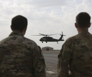 In this Monday, March 19, 2018 photo, a UH-60 Black Hawk helicopter carrying US advisers and Afghan trainees takes off at Kandahar Air Field, Afghanistan.