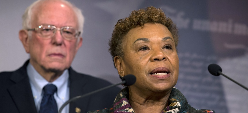 Rep. Barbara Lee, D-Calif., flanked by Sen. Bernie Sanders, I-Vt., speaks during a news conference on a measure limiting President Donald Trump's ability to take military action against Iran, on Capitol Hill, in Washington, Thursday, Jan. 9, 2020.