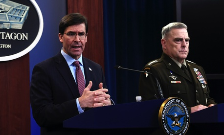 Defense Secretary Mark Esper, left, joined by Joint Chiefs​ Chairman Gen. Mark Milley, right, speaks during a news conference at the Pentagon in Washington, Friday, Dec. 20, 2019.