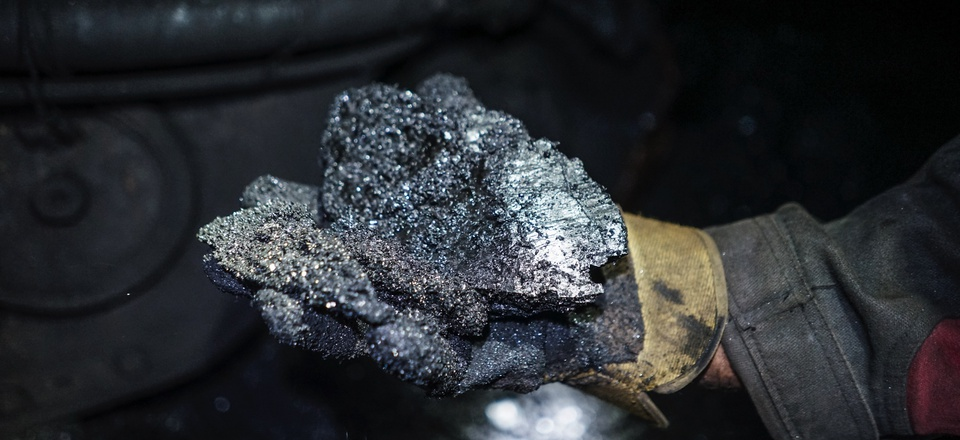 In this 2015 photo, a miner shows a lump of coal at one of the Krasnodonugol coal mines in Krasnodon, eastern Ukraine.