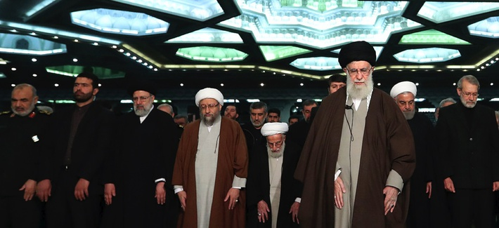 In this photo released by the official website of the office of the Iranian supreme leader, Supreme Leader Ayatollah Ali Khamenei, center, leads the Friday prayers at Imam Khomeini Grand Mosque in Tehran, Iran, Friday, Jan. 17, 2020.