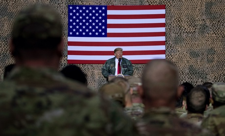 President Donald Trump speaks at a hangar rally at Al Asad Air Base, Iraq, Wednesday, Dec. 26, 2018.
