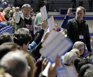 Precinct 68 Iowa Caucus voters seated in the Biden section hold up their first votes as they of the caucus as they are counted at the Knapp Center on the Drake University campus in Des Moines, Iowa, Monday, Feb. 3, 2020.