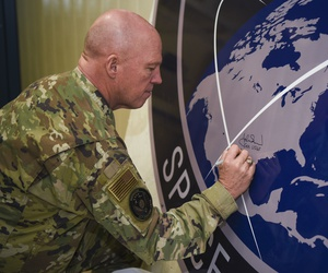 Gen. John Raymond, U.S. Space Force chief of space operations, signs the United States Space Command sign inside of the Perimeter Acquisition Radar building Jan. 10, 2020, on Cavalier Air Force Station, North Dakota.