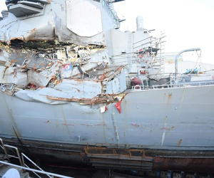 The Arleigh Burke-class guided-missile destroyer USS Fitzgerald (DDG 62) sits in Dry Dock 4 at Fleet Activities (FLEACT) Yokosuka to continue repairs and assess damage sustained from its June 17 collision with a merchant vessel.