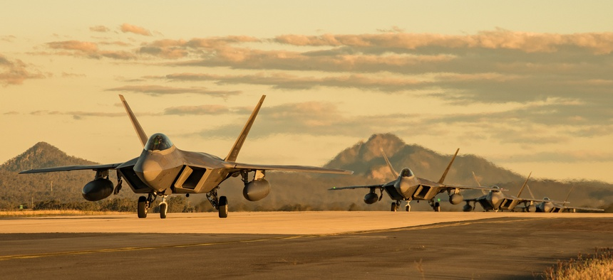 U.S. Air Force F-22 Raptors taxi at Royal Australian Air Force Base Amberley during a July 2019 exercise.
