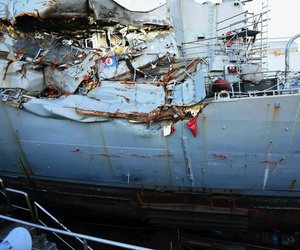This July 11, 2017, file photo provided by the U.S. Navy shows the USS Fitzgerald in dry dock in Yokosuka, Japan, for repairs and assessment of damage sustained from a June 17 collision with a cargo ship in the waters off of Japan.