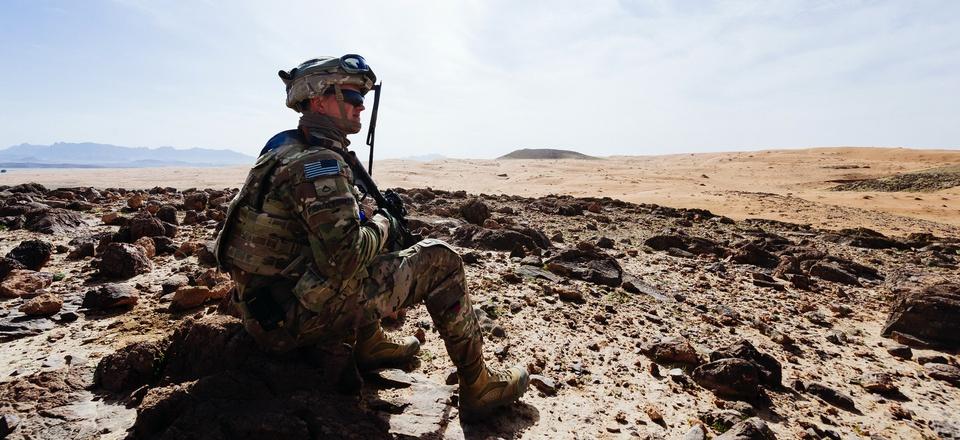 A U.S. soldier surveys a training ground near Kandahar, Afghanistan, March 14, 2017.