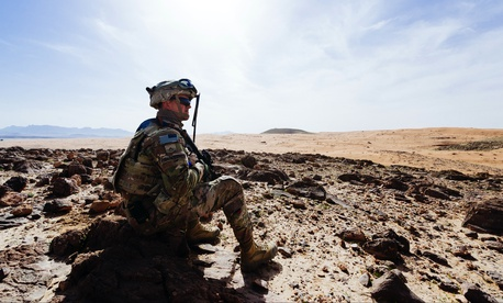 A U.S. soldier surveys a training ground near Kandahar, Afghanistan, March 14, 2017.