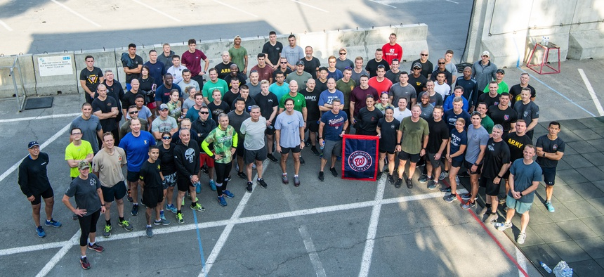 Defense Secretary Mark T. Esper participates in a PT session with service members and Civilians at Camp Resolute Support, Kabul, Afghanistan, Oct. 21, 2019.