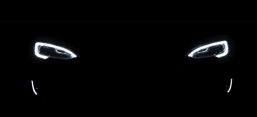 The running lights of a Tesla electric vehicle