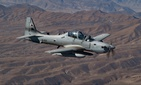 An Afghan pilot conducts training in an A-29 Super Tucano over Kabul, Afghanistan as part of the Train Advise and Assist Command's (TAAC-Air) mission on Dec. 20, 2018.