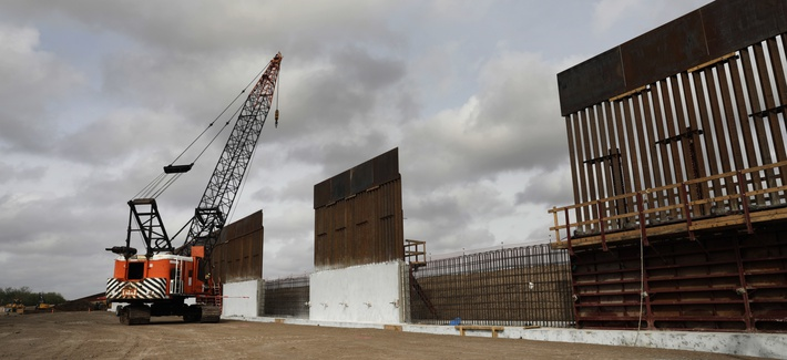 Construction crews work to erect levee wall system in a remote area south of Weslaco, Texas in the U.S. Border Patrol's Rio Grande Valley Sector. Jan. 13, 2020.