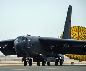 Al Udeid Air Base - An Air Force B-52 Stratofortress aircraft deploys its rear chute after touching down at Al Udeid Air Base, Qatar, April 9, 2016.