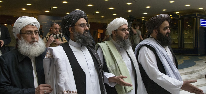 In this file photo taken on Tuesday, May 28, 2019, Mullah Abdul Ghani Baradar, the Taliban group's top political leader, second from left, arrives with other members of the Taliban delegation for talks in Moscow, Russia.