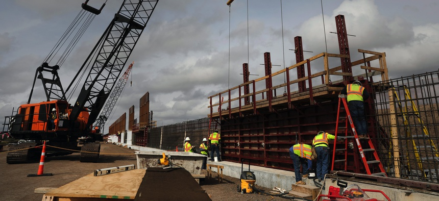 Construction crews work to erect levee wall system in a remote area south of Weslaco, Texas in the U.S. Border Patrol's Rio Grande Valley Sector. Jan. 13, 2019.