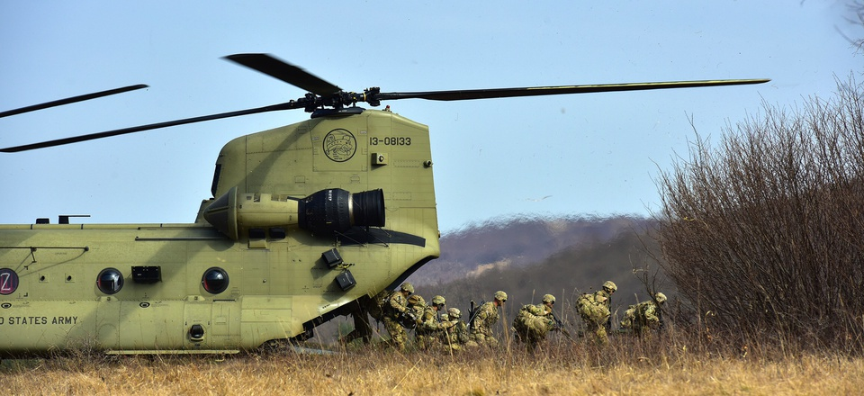 U.S. Army Paratroopers assigned to 1st Battalion, 503rd Infantry Regiment, 173rd Airborne Brigade, exit from a 12th Combat Aviation Brigade CH-47 Chinook helicopter, during Exercise Eagle Sokol at Pocek Range in Slovenia, Mar. 25, 2019.