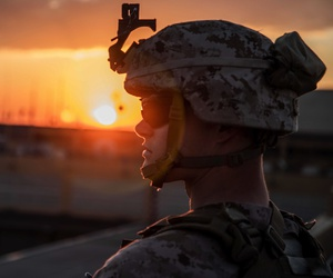 A Marine stands watch during the security reinforcement of the U.S. Embassy compound in Baghdad, Jan. 4, 2020.